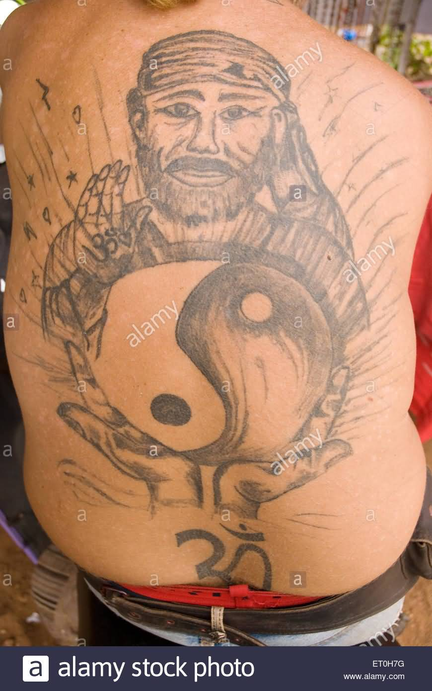Full Back Om Symbol And Yin Yang Sai Baba Face Tattoo