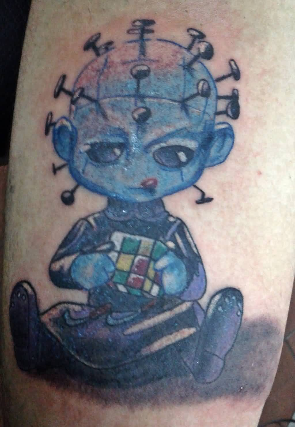 Funny Blue Ink Alien Pinhead Face With Colorful Cube Tattoo
