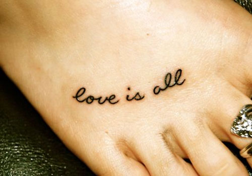 Girl Foot Black Ink Love Is All Text Tattoo