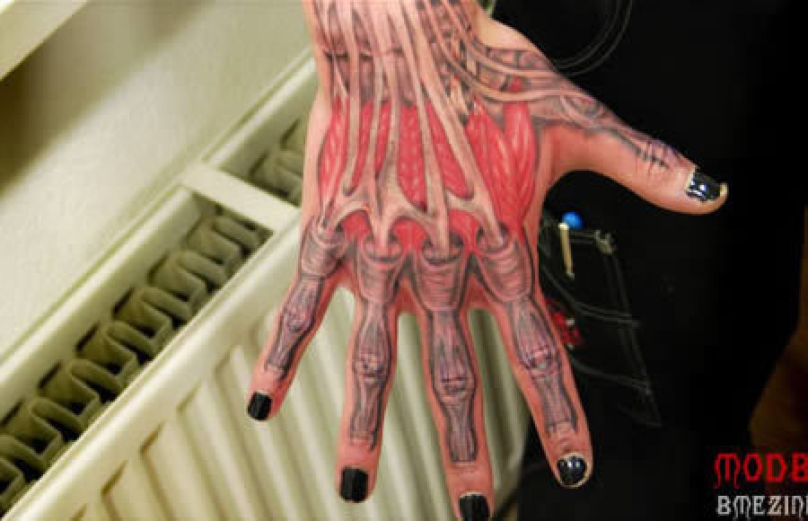 Girl Hand With Inner Muscles Tattoo