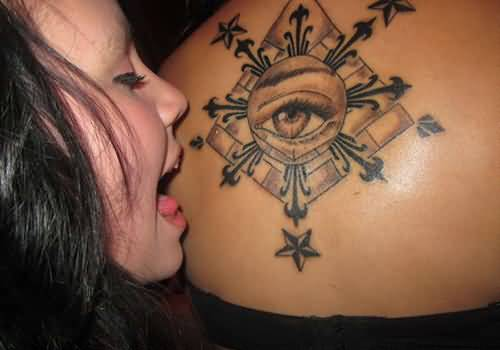 Girl Kiss Filipino Eye Tattoo On Lower Back