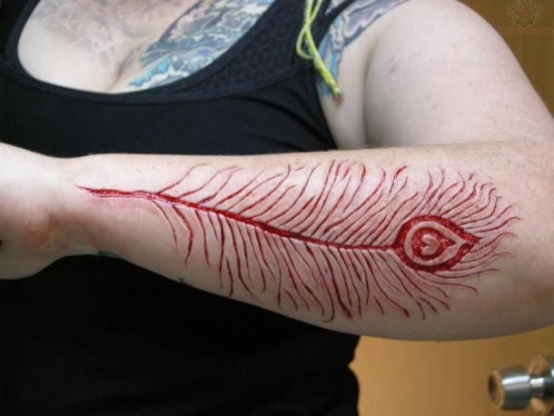 Girl Lower Sleeve Nice Scarification Peacock Feather Tattoo