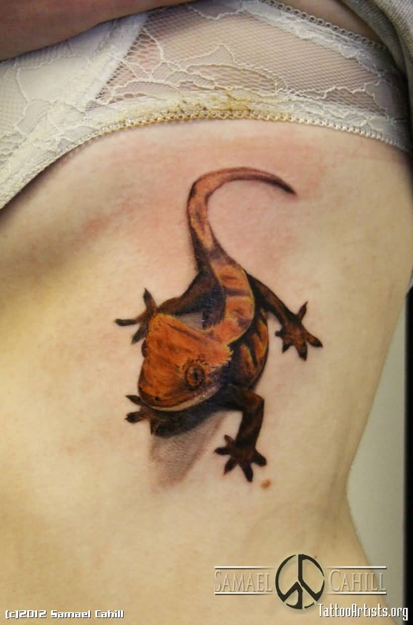Girl Rib Side With Orange Reptile Small Lizard Tattoo