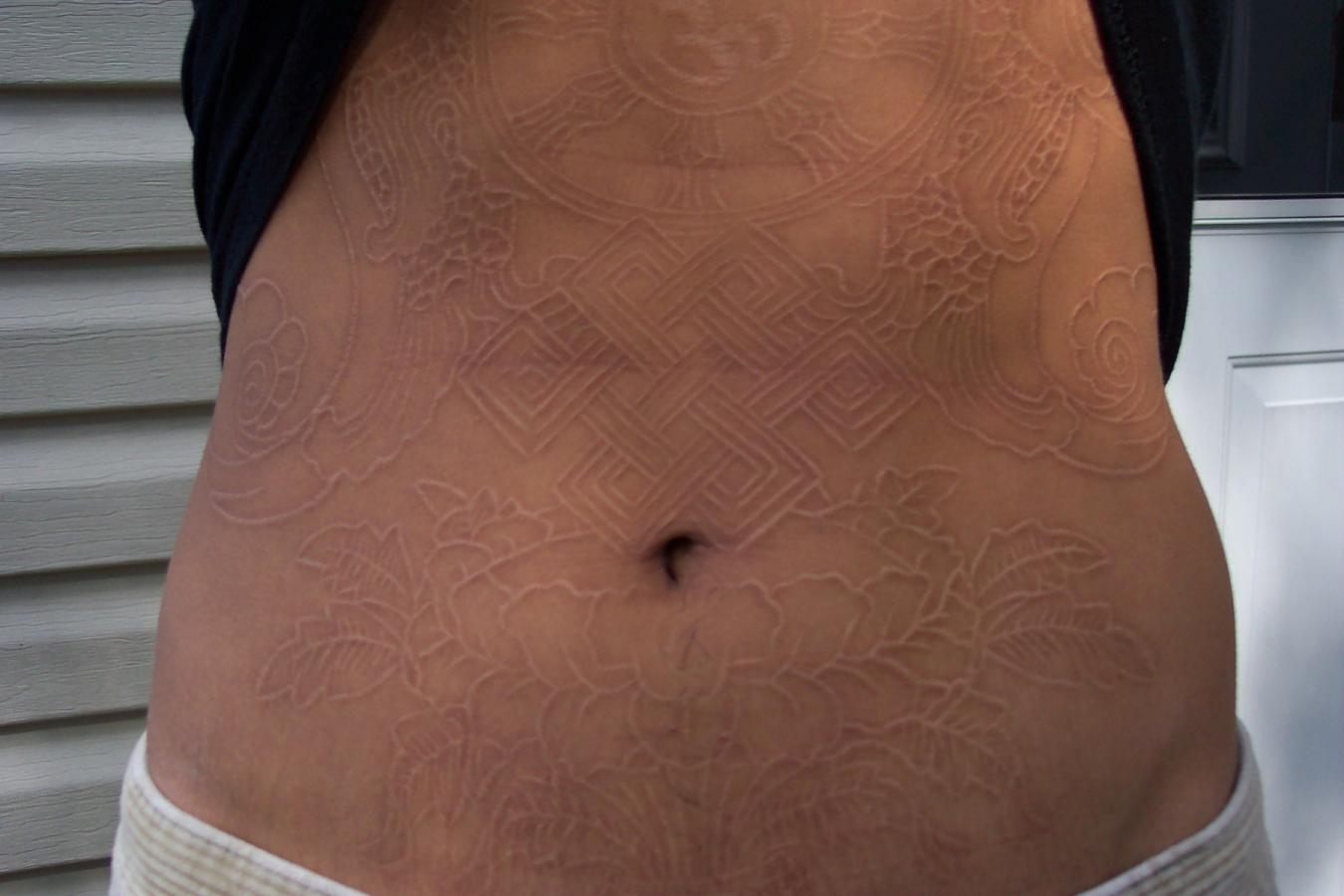 Girl Show Amazing Scarification Tattoo Design Idea