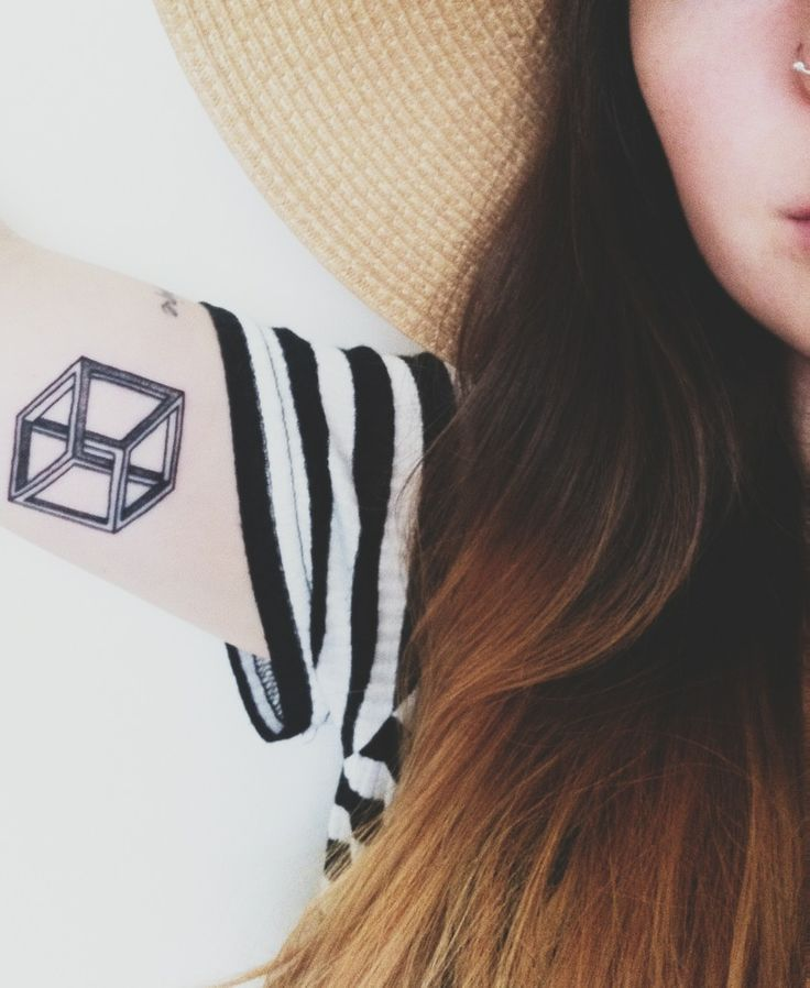 Girl Show Nice Escher Cube Tattoo On Bicep