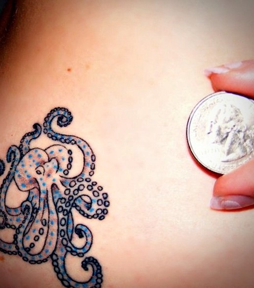 Girl Show Old Coin And Sea Creature Octopus Tattoo