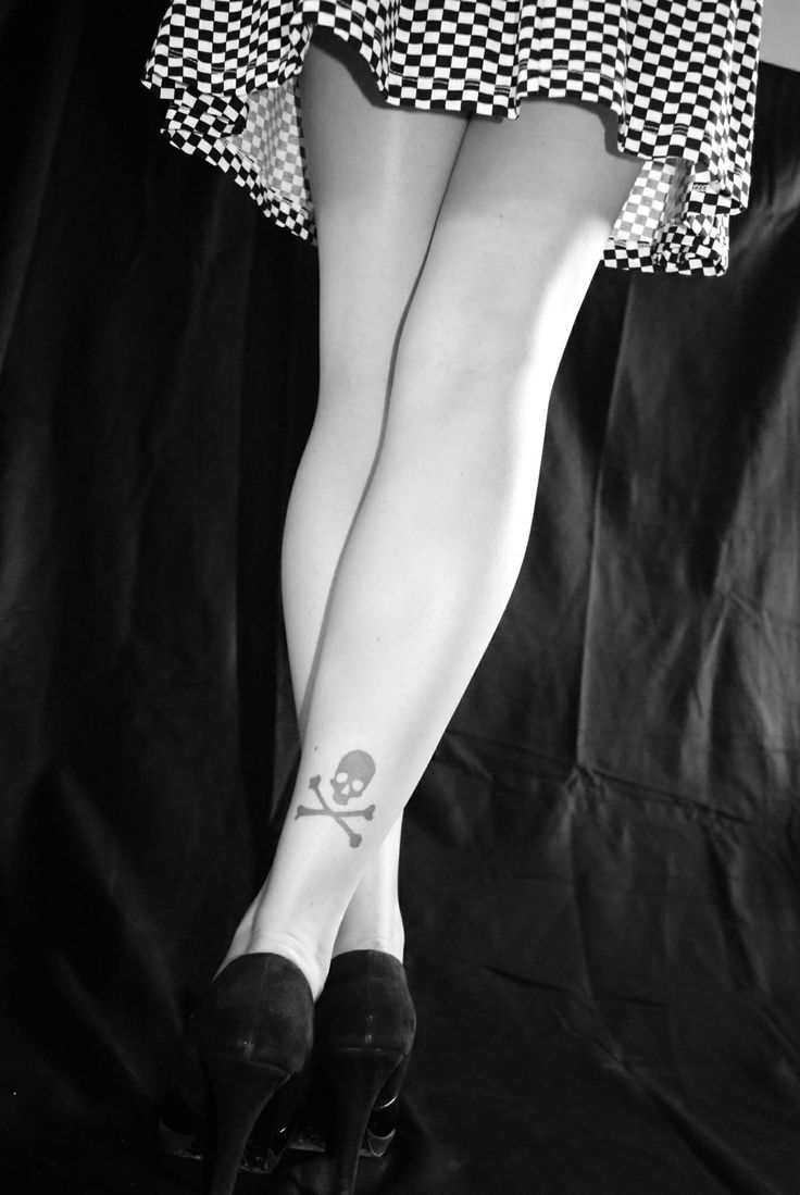 Girl Show Simple Jolly Roger Tattoo On Leg Back