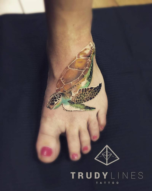 Girl Showing Awesome Reptile Turtle Tattoo On Foot