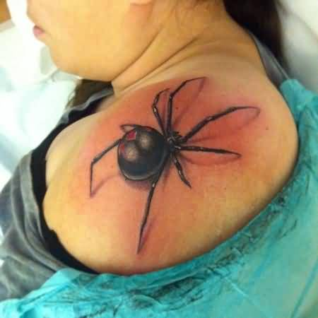 Girl Showing Her Awesome Black Widow Tattoo On Upper Shoulder
