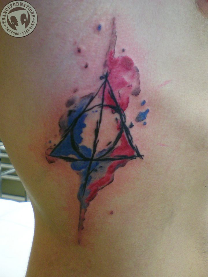 Girl Side Rib Watercolor Deathly Hallows Tattoo