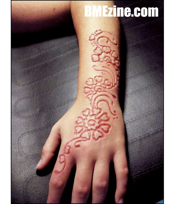 Girl Upper Wrist To Hand Nice Scarification Flower Tattoo