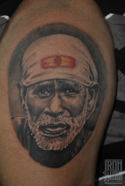 Great And Awesome Face Of Sai Baba Tattoo
