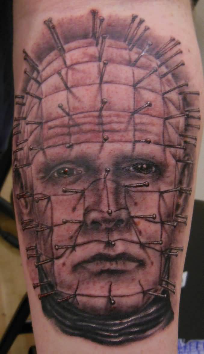 Great And Simple Pinhead Face Tattoo