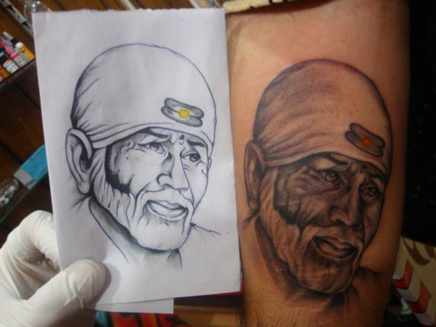 Great Stencil With Awesome Sai Baba Face Tattoo Phot