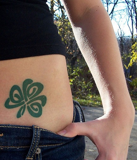 Green Ink Nice Celtic And Nice Shamrock Tattoo Design On Girl Hip