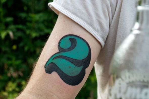 Green Ink Nice Two Number Tattoo Design For Bicep