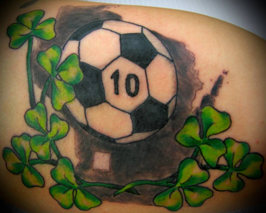 Green Shamrock And Football Tattoo