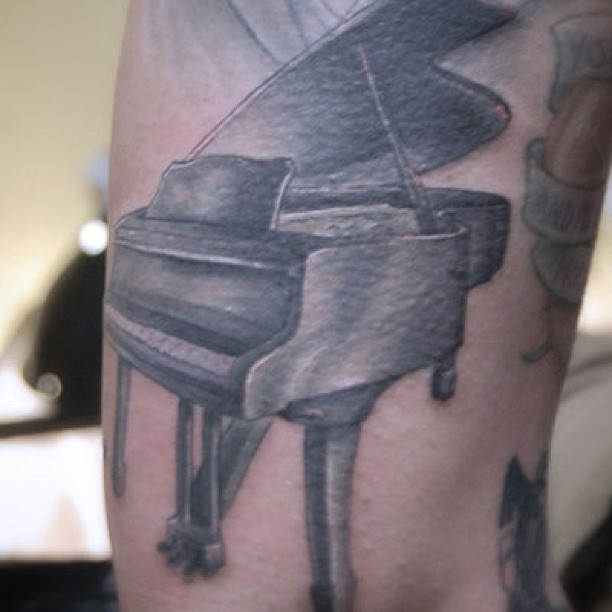 Grey Ink Awesome And Nice Grand Piano Tattoo Design Idea
