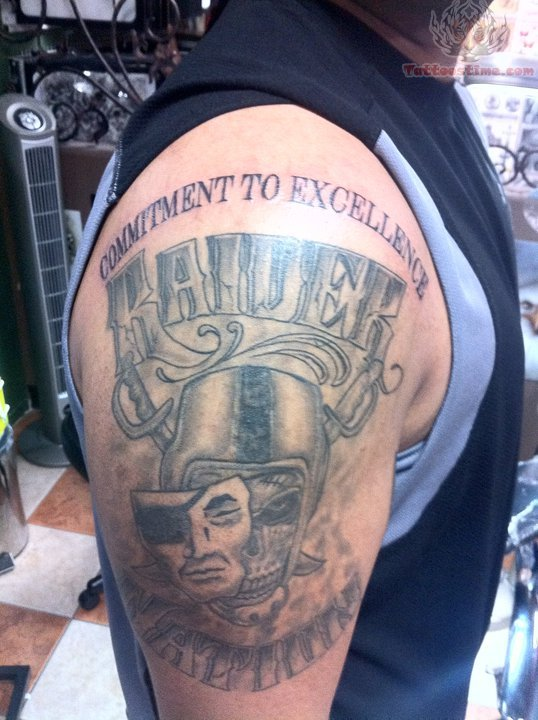 Grey Ink Half Sleeve Mask And Oakland Raiders Tattoo