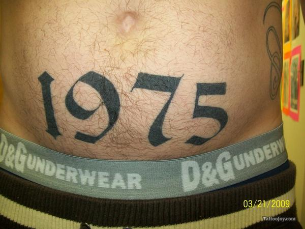 Grey Ink Nice Memorable 1975 Date Number Tattoo For Men