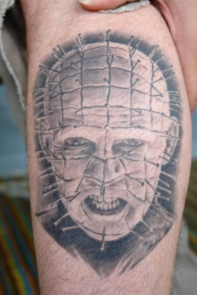 Grey Ink Simple Pinhead Face Tattoo Design Idea
