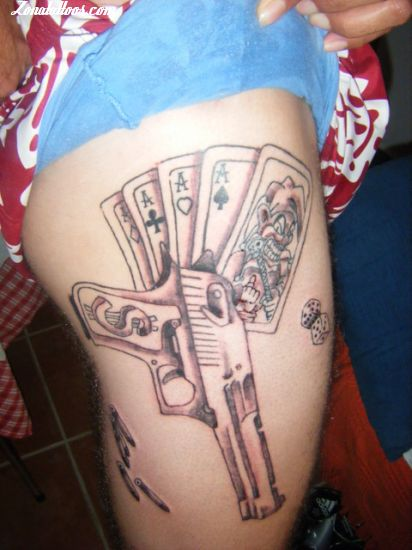 Gun With Playing Latino Cards Tattoo Design Idea On Girl Thigh