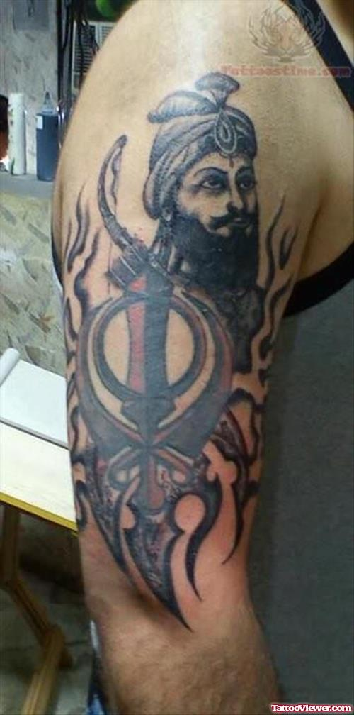 Guru Gobind Ji Face With Punjabi Khand Tattoo On Men Half Sleeve