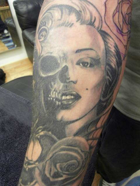 Half Marilyn Monroe Face And Skull Tattoo With Rose Flower On Sleeve