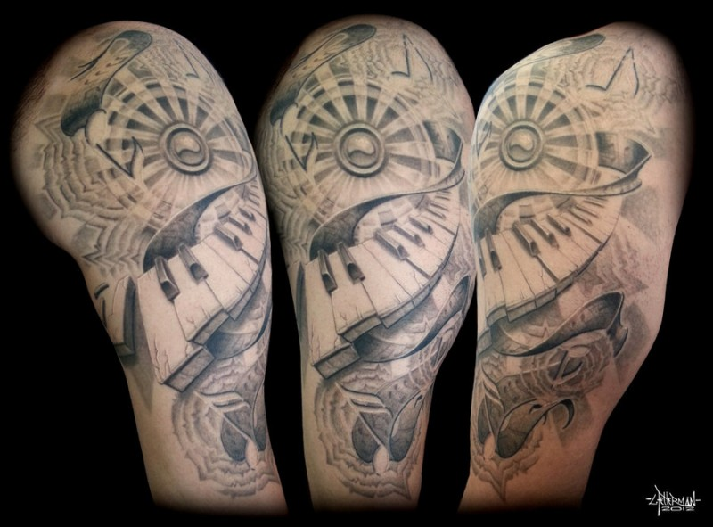 Half Sleeve Amazing And Awful Piano Keys Tattoo