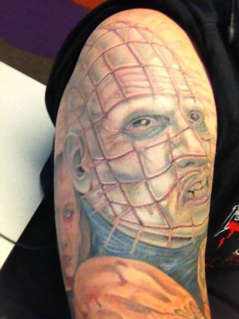 Half Sleeve Awesome Pinhead Face Tattoo Design Idea