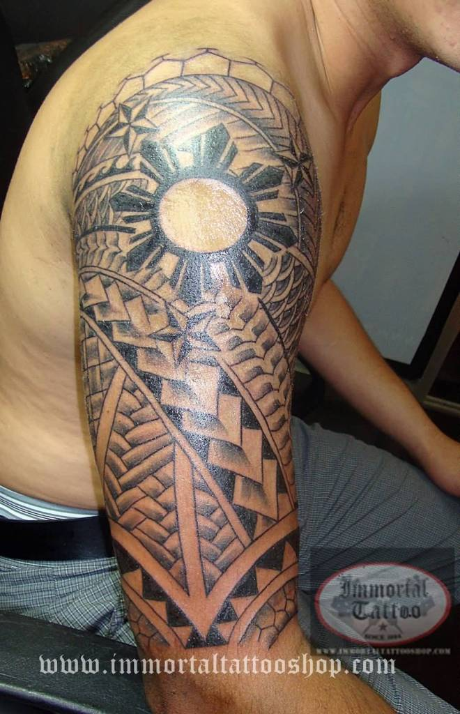 Half Sleeve Filipino Sun And Tribal Tattoo For Men