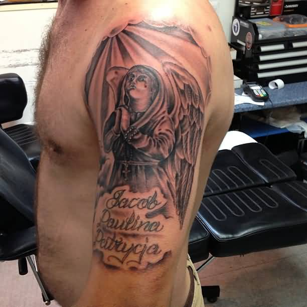 Half Sleeve Grey Ink Praying Angel With Text Tattoo