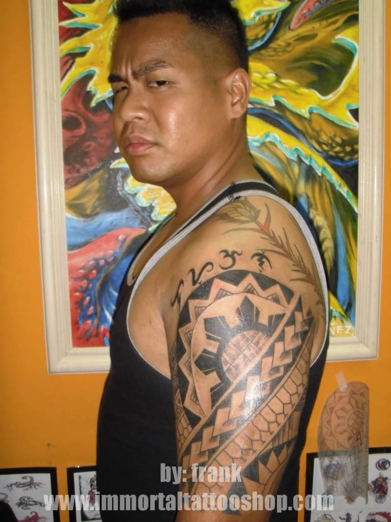 Half Sleeve Nice Filipino Sun And Tribal Tattoo For Men