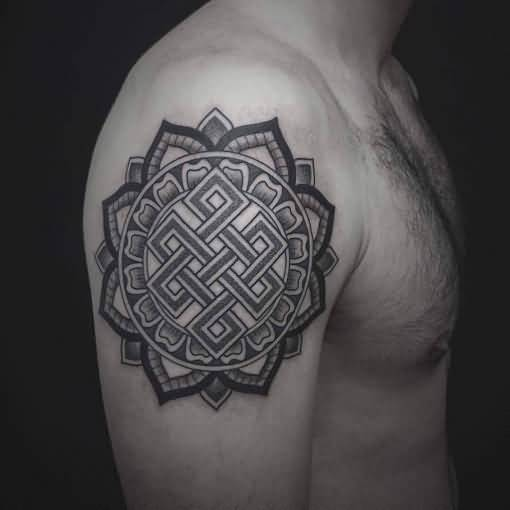 Handsome Men Show Nice Endless Knot In Nice Lotus Tattoo