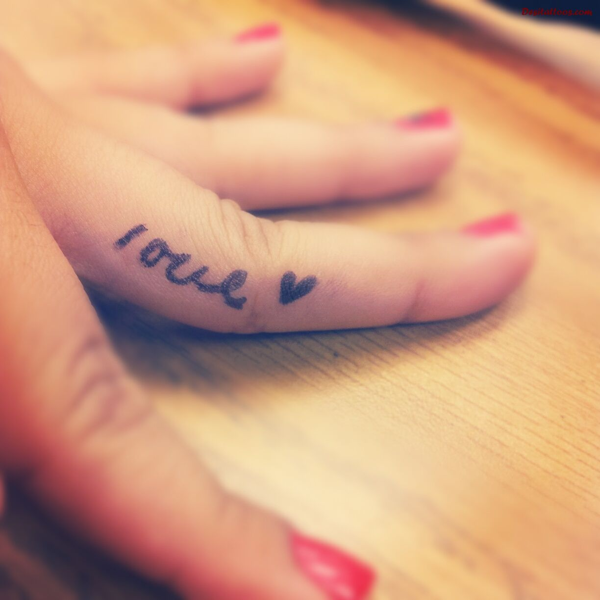 Heart Love Tattoo On Girl Finger