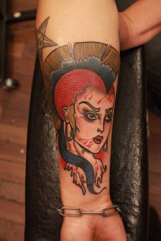 Hot Girl Punk Face Tattoo On Wrist