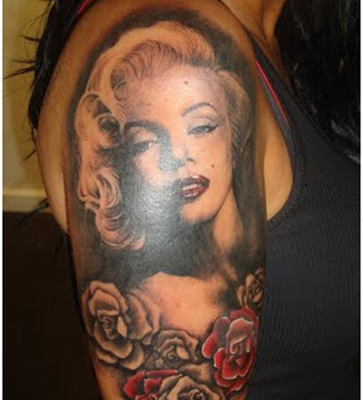Hot Girl Show Famous Marilyn Monroe Tattoo Deisgn With Roses Flower Make On Half Sleeve
