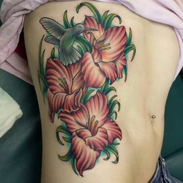 Hot Girl Show Nice And Amazing Gladiolus Flowers Tattoo On Side Rib