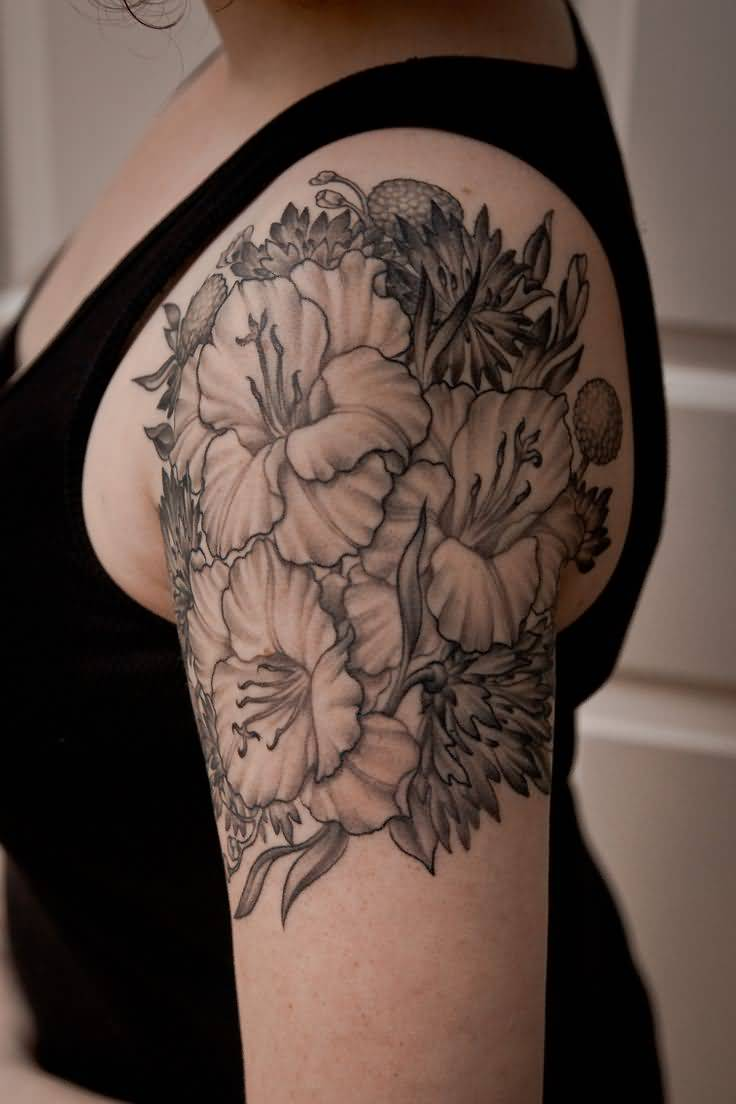 Hot Girl Show Nice Black And Grey Gladiolus Flower Tattoo On Shoulder