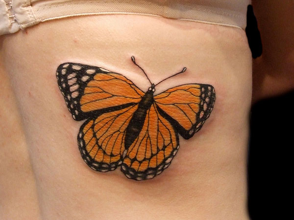 Hot Girl Showing Her Nice Monarch Butterfly Tattoo On Back