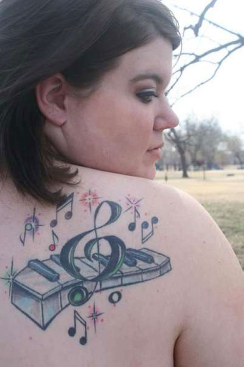 Hot Girl Upper Back Nice And Amazing Piano Keys Tattoo Design Idea