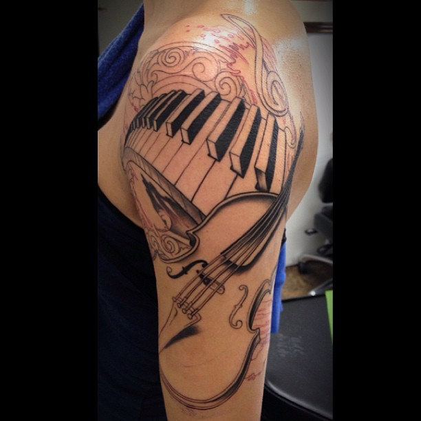Hot Women Half Sleeve Awful Piano Keys With Guitar Tattoo
