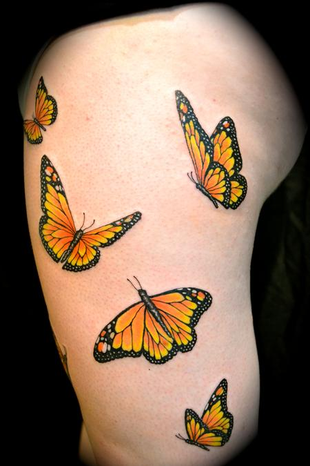 Hot Young Girl Show Her Nice Flying Monarch Butterflies Tattoo