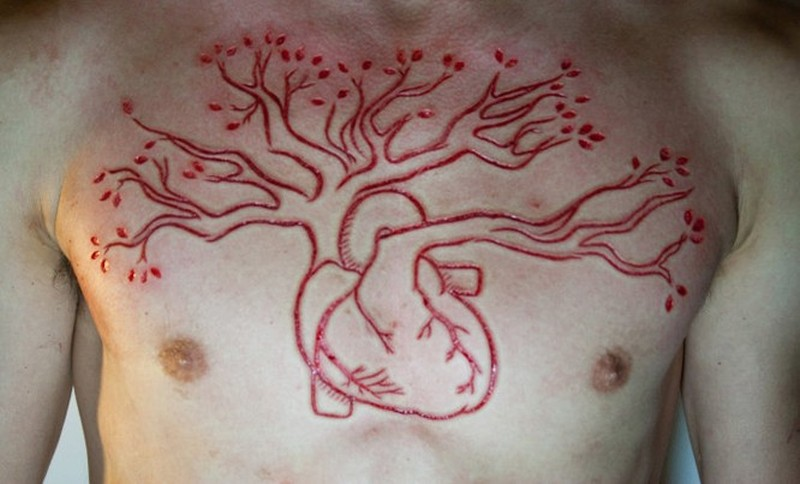 Human Heart Tree Of Life Scarification Tattoo On Chest For Men