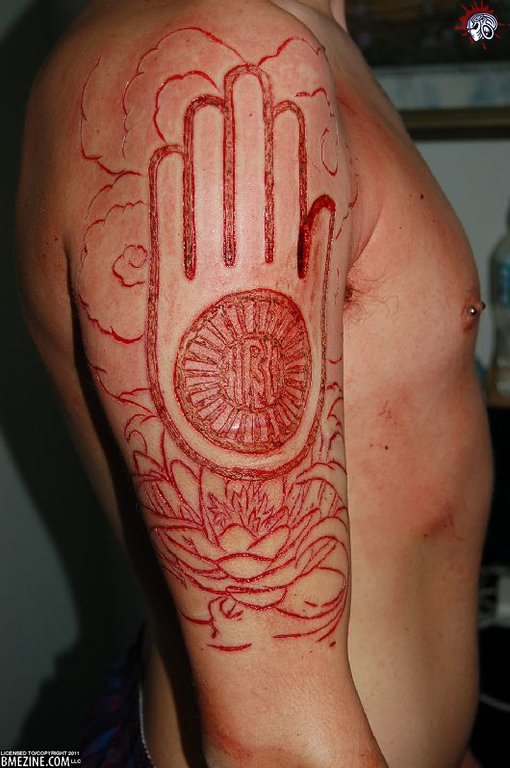 Indian Hand And Scarification Flower Tattoo On Men Upper Sleeve