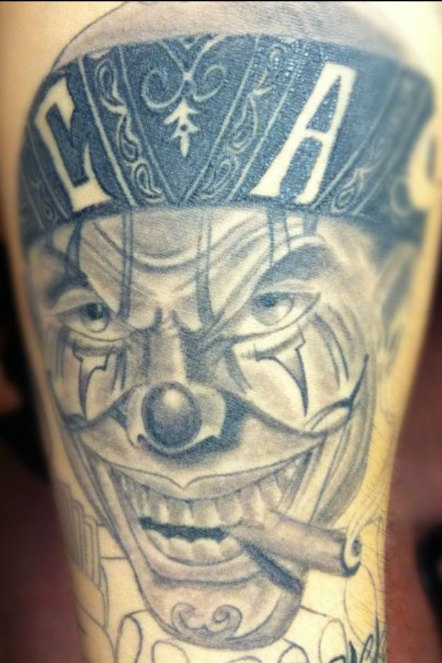 Latino Gangsta Smoking Clown Face Tattoo