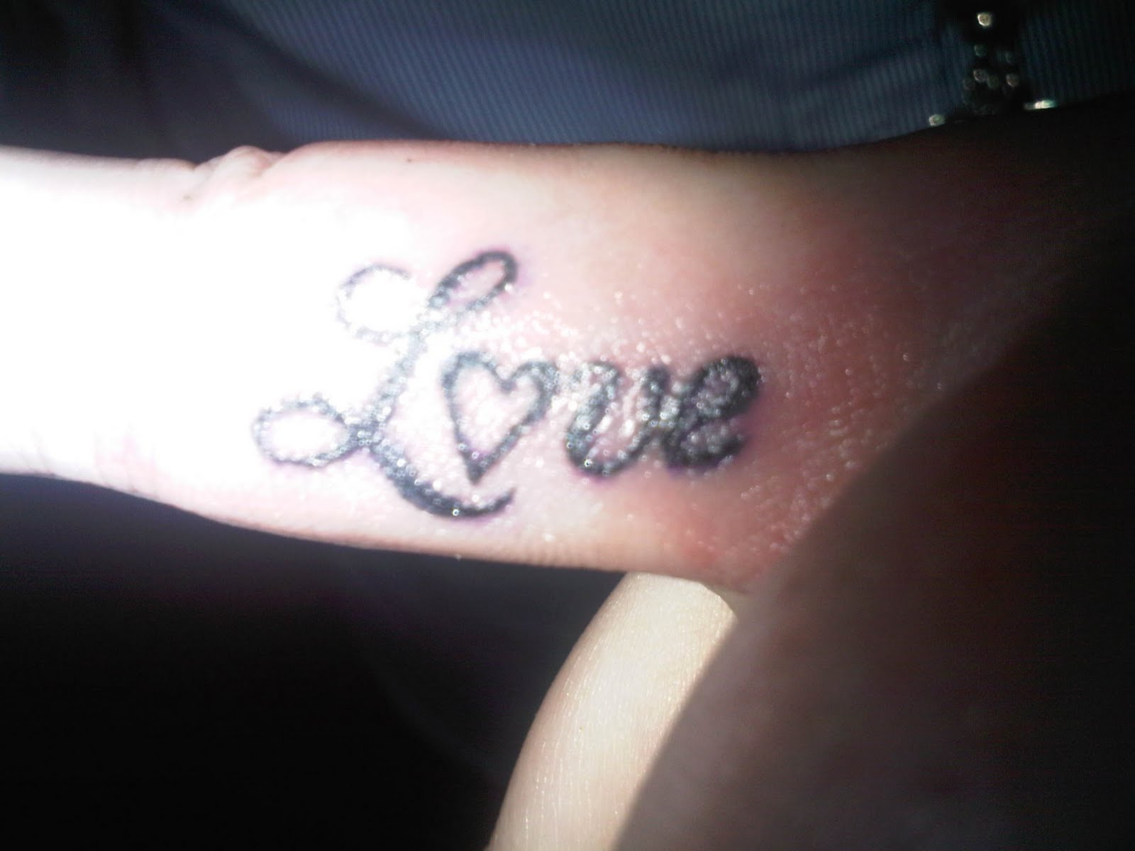 Love Black Heart Tattoo On Inner Finger
