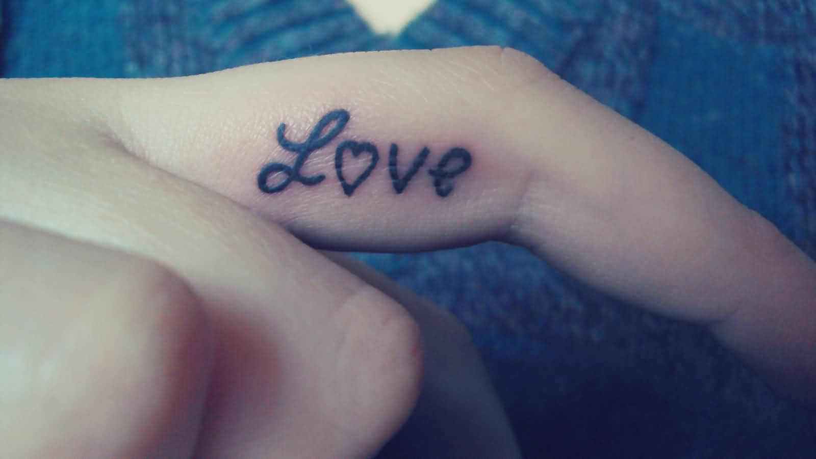 Love Heart Nice Text Tattoo On Finger