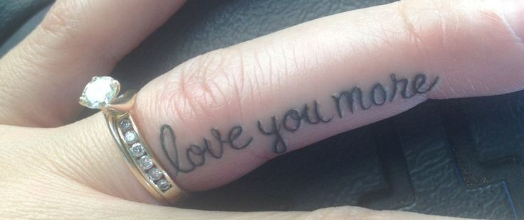 Love You More Grey Ink Text Tattoo On Finger