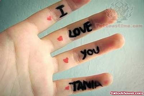Love You Tania Tattoo On Inner Fingers
